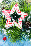 Star Christmas decoration over decorated tree Stock Images