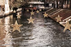 Star Christmas decorations in Treviso, Italy. Star decorations for Christmas purpose, on Sile river, in Treviso city, in Veneto, Italy Royalty Free Stock Image
