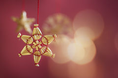 Star christmas tree decoration on red background Royalty Free Stock Photos