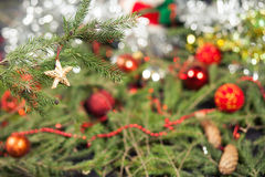 Star Christmas Tree Decoration. Wooden star decoration on a Christmas tree branch Royalty Free Stock Photo