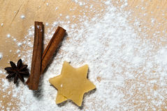 Star with cinnamon sticks and star anise V1. Star with cinnamon sticks and star anise in the flour with text space Royalty Free Stock Image
