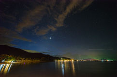 Star and comet in the sky at Khanom beach of Thailand, Nakhon Si Thammarat province. Royalty Free Stock Image