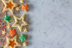 Star Cookies from Above on Marble Stock Images