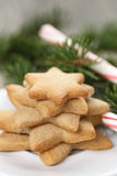 Star cookies and candy cane on table Royalty Free Stock Images