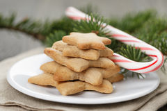 Star cookies and candy cane on table Stock Image