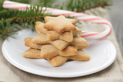 Star cookies and candy cane on table Stock Images