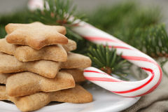 Star cookies and candy cane on table Royalty Free Stock Image