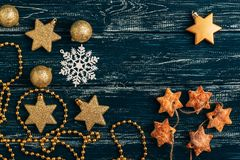 Star cookies, Christmas balls and a snowflake on an old wooden background. Royalty Free Stock Photography