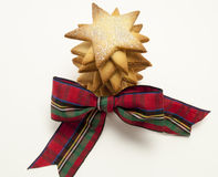 Star cookies and a Christmas Bow Royalty Free Stock Image