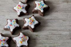 Star Cookies with Icing and Sprinkles on Wood Stock Image