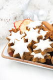 Star cookies, nuts and spices for Christmas in a bowl Royalty Free Stock Photography