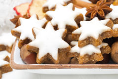 Star cookies, nuts and spices for Christmas, close-up Stock Photo