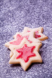 Star cookies with red jelly and powder sugar Royalty Free Stock Images