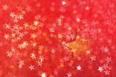 Star covered. A decently burned seasonal background with a subtle line structure, also adapted by the big star, coming out from deep down under the ground. The Stock Images