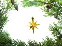 Star cristmas. Cristmas star in frame of the branches of the pine Royalty Free Stock Photos