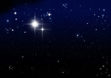 Star on the dark blue Stock Images