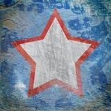 Star on dark grunge background Stock Images