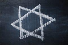 Star of david. A star of david drawn with a chalk on a blackboard Stock Photo