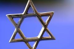 Star of David. Jewish Star of David on Blue Background royalty free stock photography