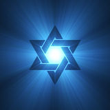 Star of David symbol blue light flare. Shield of David. Magen sign. Six pointed star shining starlight halo. Christmas, religious background stock illustration