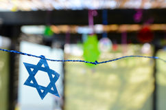 Star of David decorations inside a Jewish family Sukkah Stock Images