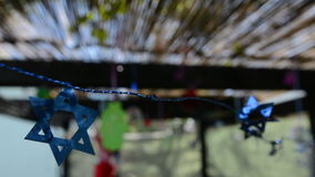 Star of David decorations inside a Jewish family Sukkah for the Jewish festival of Sukkot stock footage