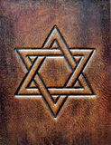 The Star of David, embossed to the aged brown leather stock image