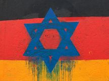 Star of David on a German Flag. Berlin wall monument on the East Side Gallery stock photos