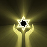 Star of David hand support light flare Stock Photo