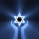 Star of David hand support light flare. Star of David (Shield of David, Magen David) symbol with powerful blue light halo Royalty Free Stock Images