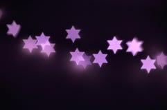Star of David lights for Hanukkah. Beautiful bokeh lights in shape of the Star of David for Hanukkah celebration. Jewish Holiday background Royalty Free Stock Image