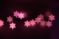 Star of David lights for Hanukkah. Beautiful bokeh lights in shape of the Star of David for Hanukkah celebration. Jewish Holiday background Stock Image