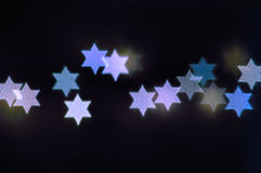 Star of David lights for Hanukkah. Beautiful bokeh lights in shape of the Star of David for Hanukkah celebration. Jewish Holiday background stock images