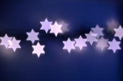 Star of David lights for Hanukkah. Beautiful bokeh lights in shape of the Star of David for Hanukkah celebration. Jewish Holiday background