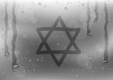 Star of David sign draw on rainy window. Finger draw star of David sign on rain gray background. Water hand writing religious symbol on glass surface Stock Image