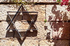 Star of David on the stone wall royalty free stock photography