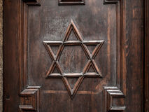 Star of David. Symbol of Star of David on old synagogue wooden door Stock Photography
