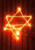 Star of David symbol painted with sparkler's light Stock Image