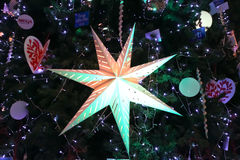 Star for Decorate Christmas tree. Christmas tree with Decorated ornament star Stock Image
