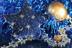 Star decoration, Christmas ornament on blue background Royalty Free Stock Photography