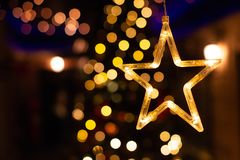 Star decoration, New year light bokeh, Yellow decor lights royalty free stock images