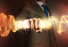 Star dust. Close up of businessman hand holding light ray in fist Stock Photography