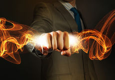 Star dust. Close up of businessman hand holding light ray in fist Royalty Free Stock Images