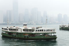 Star Ferry arrives to Kowloon pier in Hong Kong, China. Royalty Free Stock Photography