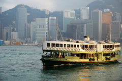 Star Ferry boats crossing Victoria Harbour Royalty Free Stock Photo