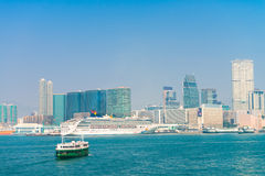 Star Ferry, crossing the channel to Kowloon and a luxury cruise Royalty Free Stock Photos