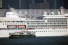Star Ferry and Cruising Ship Stock Images