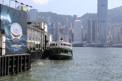 Star ferry floating in Hong Kong Victoria Harbour in a sunny day Stock Images