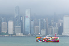 The Star Ferry passes across Victoria harbour. royalty free stock image