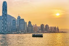 Star ferry at the Victoria Harbor of HK at sundown Stock Images